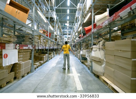 man  in big storehouse photo - stock photo