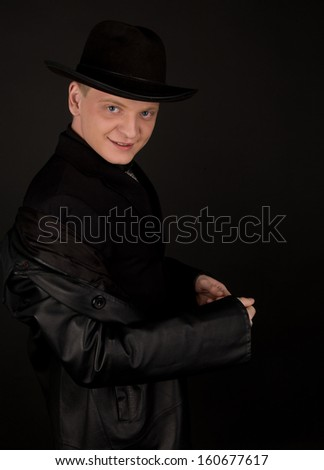 Man in black fedora looking to the camera - stock photo