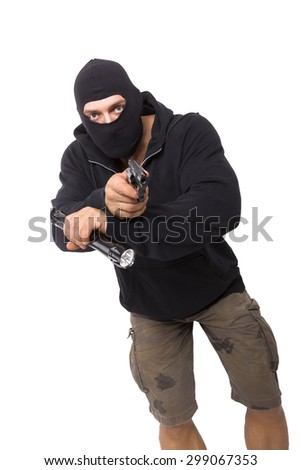 Man in black mask and black cloth holding flashlight and gun isolated on white background. Dangerous criminal committing crime. - stock photo