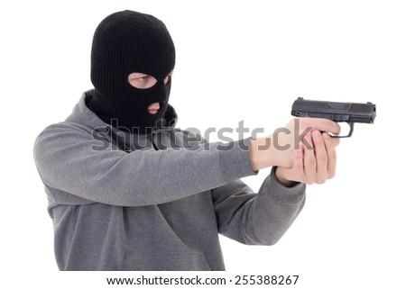 man in black mask shooting with gun isolated on white background - stock photo