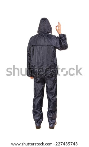 Man in black rain coat. Isolated on a white background. - stock photo