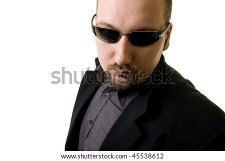 man in black suit and glasses - stock photo