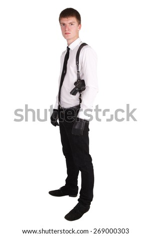 man in black suit and handgun isolated on white - stock photo