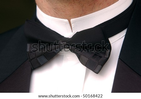 Man in black suit with bow tie - stock photo