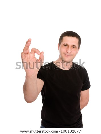man in black t-shirt is showing sign ok isolated on white background - stock photo