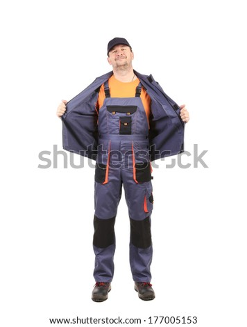 Man in blue overall. Isolated on a white background. - stock photo