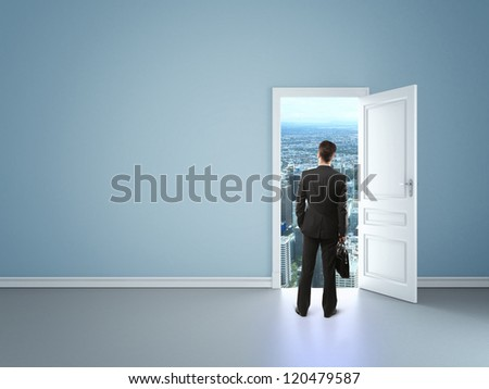 man in blue room with door in city - stock photo