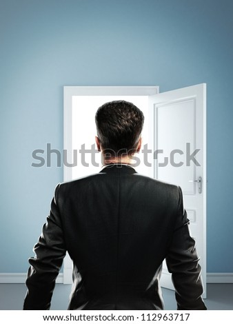 man in blue room with doors open - stock photo