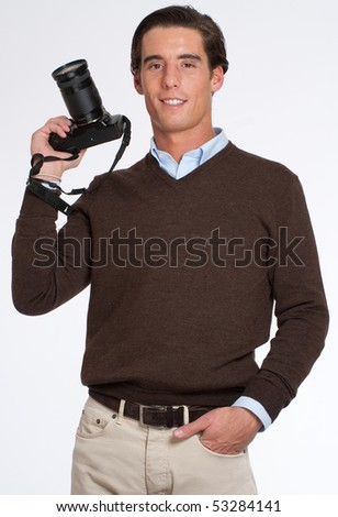 Man in brown holding a photo camera - stock photo