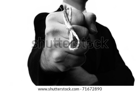 man in buisness suit with a knot around his finger to make him remember something! - stock photo