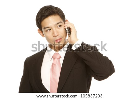 Man in business attire using a mobile phone (on white) - stock photo