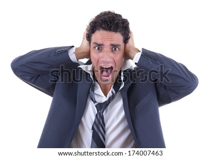 man in business suit holding his head and screaming - stock photo