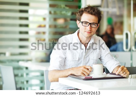 Man in cafe with coffee - stock photo