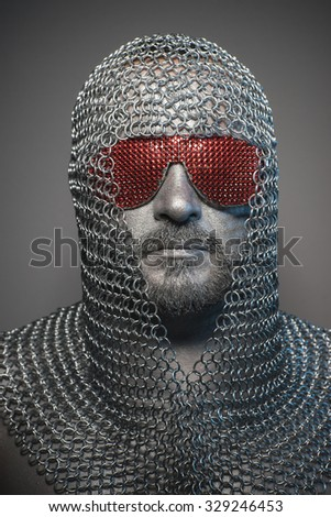 man in chain mail and leather painted silver, medieval warrior - stock photo