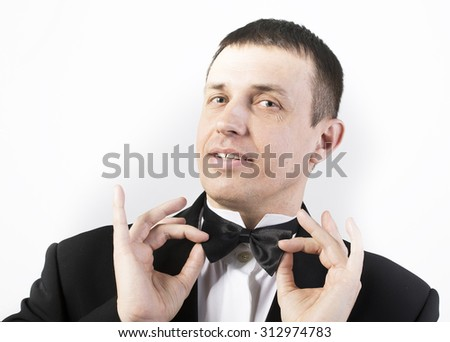 Man in classic tuxedo on white - stock photo