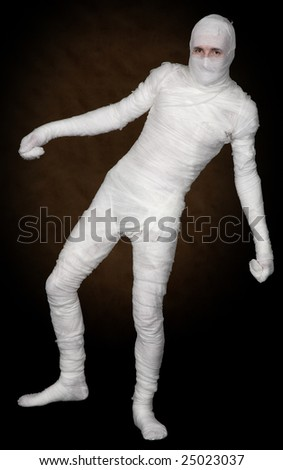 Man in clothes monster on the black background - stock photo