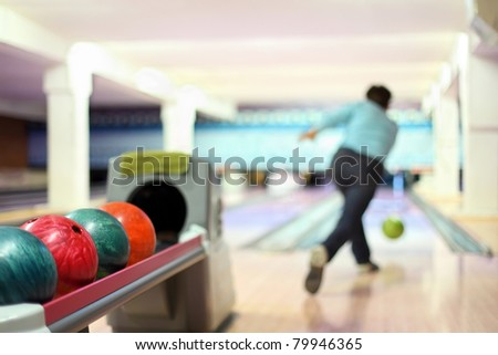 Man in club for bowling throw ball - stock photo