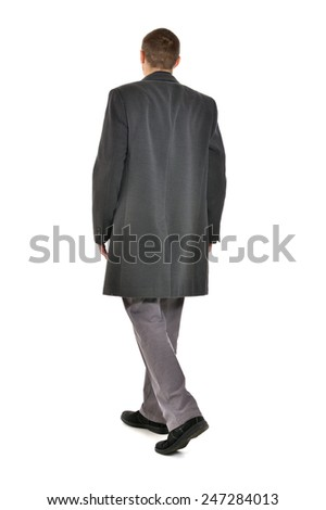 Man in coat ,full length ,back view on a white background - stock photo