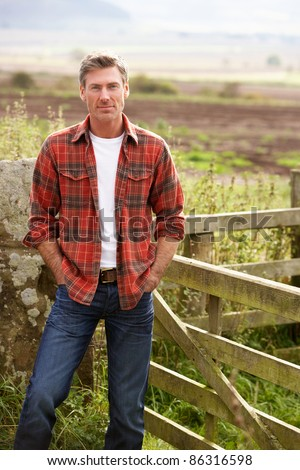 Man in countryside - stock photo