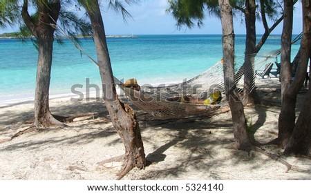 Man in Cowboy hat Relaxing in a hammock - stock photo