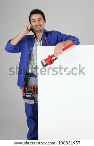 man in dungarees on the phone - stock photo
