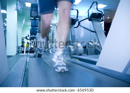 Man in  fitness club - stock photo