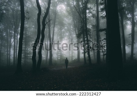 man in forest spooky halloween mood - stock photo