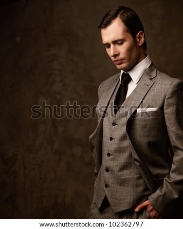 Man in grey suit. - stock photo