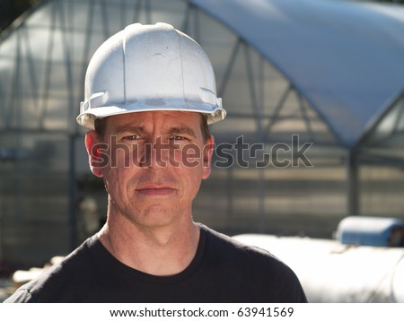 Man in Hard Hat - stock photo