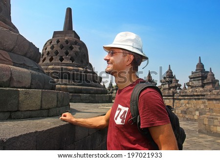 man in hat the hat in Borobudur temple - stock photo