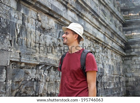man in hat the hat is studying Borobudur temple - stock photo