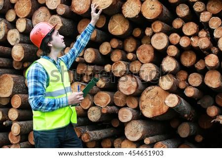 man in helmet worker wood lumber - stock photo