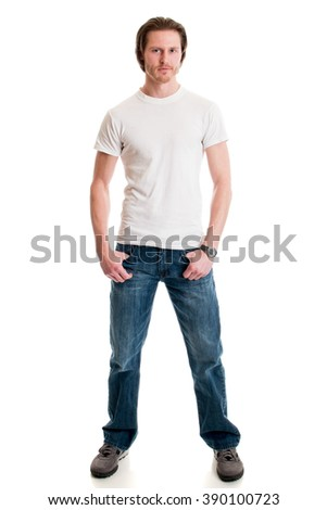 Man in jeans and white tee shirt. Studio shot over white. - stock photo