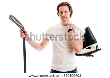 Man in jeans and white tee shirt with ice hockey equipment. Studio shot over white. - stock photo