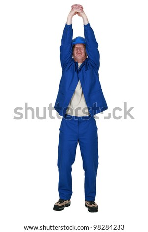 man in jumpsuit stretching his arms - stock photo