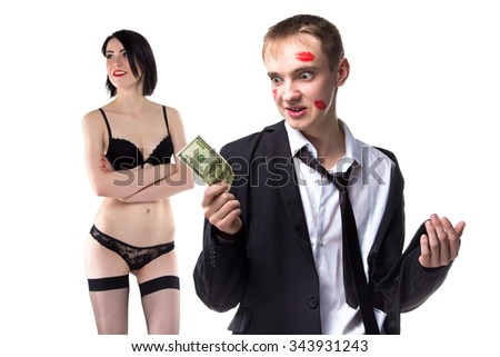 Man in kisses with 100 dollars and woman. Isolated photo of people with white background. - stock photo