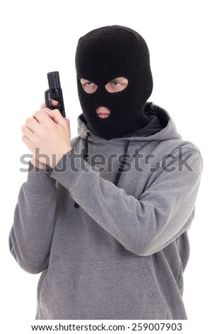 man in mask with gun isolated on white background - stock photo