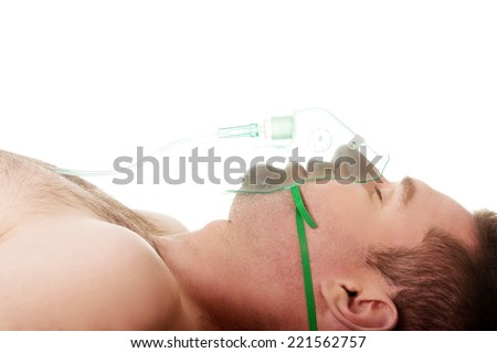 Man in mask with oxygen. - stock photo