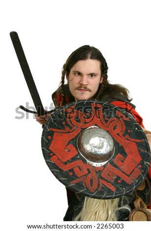 man in medieval clothes with a sword and a shield - stock photo