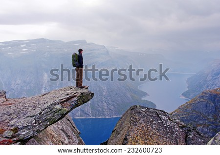Man in mountains, Trolltunga , Norway  - stock photo