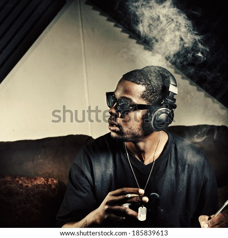 man in music studio smoking weed - stock photo
