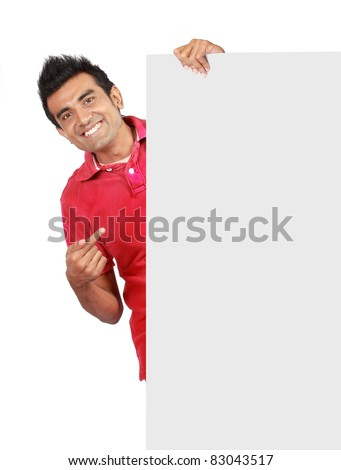man in nice red shirt smiling holding a big blank card - stock photo