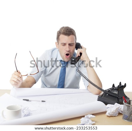 man in office screaming on the phone - stock photo