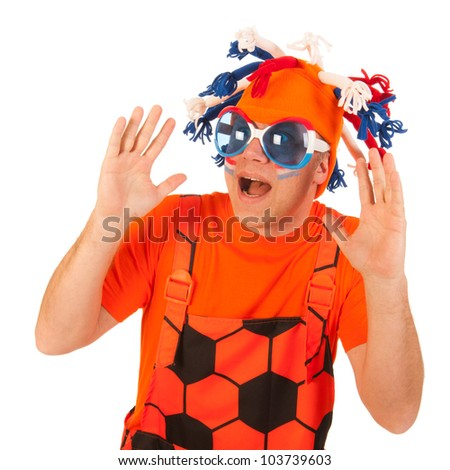 Man in orange with funny hat and orange cloths - stock photo