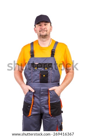 Man in overalls. Located on a white background. - stock photo