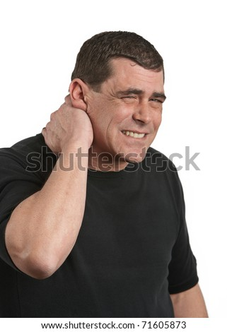 Man in pain with neck injury white background - stock photo