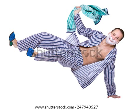 man in pajamas jumping on a white background - stock photo