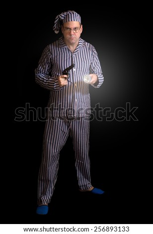 man in pajamas with a gun - stock photo