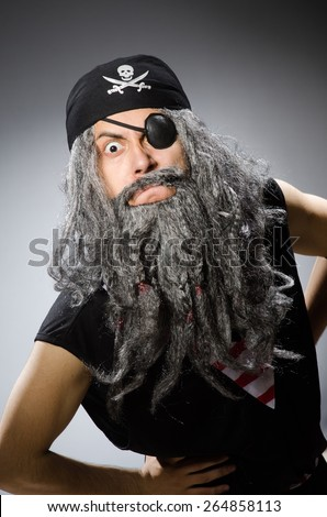 Man in pirate costume isolated on white - stock photo