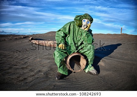 Man in protective clothing in the area of ??environmental disaster - stock photo
